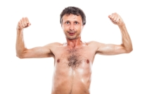 Funny man showing muscles